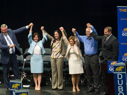 Gov. Eric Holcomb, from left, State Treasurer Kelly Mitchell, State Auditor Tera Klutz, Secretary of State Connie Lawson U.S. Senate Nominee Mike Braun and Indiana Republican Chairman Kyle Hupfer pose for a photo on stage during the Indiana Republican State Convention at the Ford Center on Saturday, June 9, 2018.
