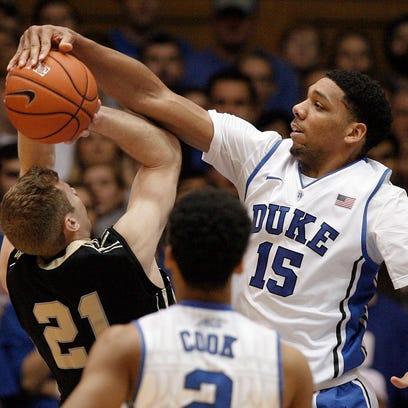 Duke Blue Devils center Jahlil Okafor (15) blocks the