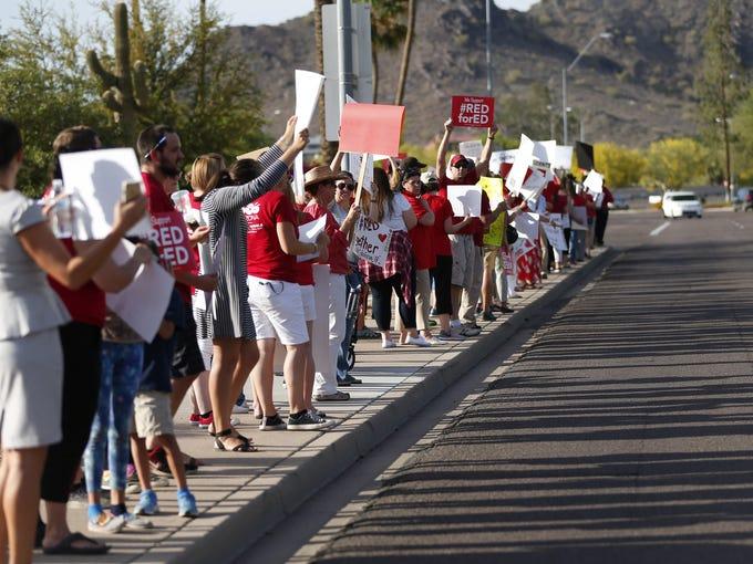 Teachers protest outside the KTAR studios in Phoenix