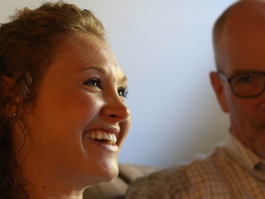 Madison Gerdts, 28, smiles next to he father Doug while recalling her journey to sobriety. She has been sober for 5 years and believes that recovery is possible for anyone if you want it bad enough.