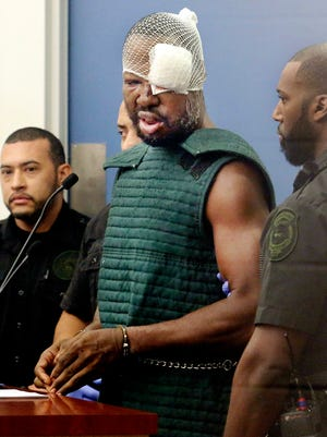 Markeith Loyd, suspected of fatally shooting a Florida police officer, attends his initial court appearance Thursday, Jan. 19, 2017, at the Orange County Jail, in Orlando. Loyd spoke out of turn and was defiant during the appearance on charges of killing his pregnant ex-girlfriend. He was injured during his arrest Tuesday, Jan. 17, 2017.
