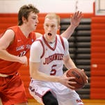 St. John's Mitchell Kuck spins around St. Mary's Nick Ogren as he drives to the basket in a game earlier this season in Collegeville.