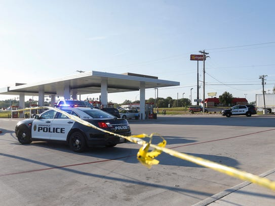 Police investigate the scene of a shooting at the Kum
