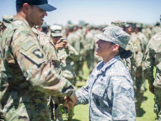 Master Sgt. Scott Roy congratulates Senior Airman Lesley Trevizo as she earns her Air Assualt Badge. Trevizo is the first woman in the Air Force to graduate from the Fort Bliss Army Air Assault School, Iron Training Detachment. Master Sgt. Roy is the first Air Force instructor to teach at the detachment.