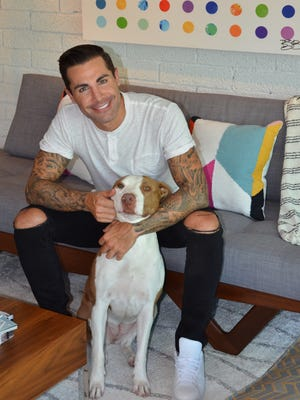 Brandon Lee, anchor at Channel 3, and his rescue dog Khaleesi in their Phoenix home.