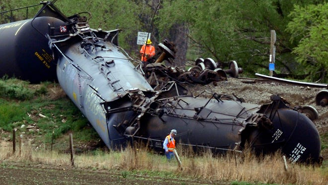 Clean up crews examine the damage at a train car derailment southwest of LaSalle, Colo. on Friday, May 9, 2014. The train, loaded in Windsor with Niobrara crude bound for New York, derailed around 8 a.m. according to Union Pacific Spokesman Mark Davis. Officials found one car of the 100-car train was leaking.