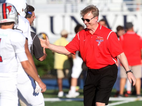 Former NY Giants quarterback Phil Simms greets coaches and players at the North-South Football Classic, Monday, June 29, 2015, at Kean University in Union, NJ.