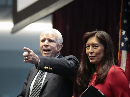U.S. Sen. John McCain reacts at the Sandra Day O'Connor College of Law at Arizona State University on Aug. 15, 2016. He is standing next to U.S. District Judge Diane Humetewa. Several guests including McCain and Phoenix Mayor Greg Stanton spoke in advance of the formal open house for the new law-school building.