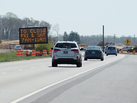 A DelDot sign warns drivers about the upcoming closure of the crossovers along Del. 1 adjacent to DE Turf Sports Complex in Frederica.