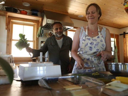 Pedro Betancourt and his wife, Elizabeth, make dinner at their Oliview farm in Anderson.