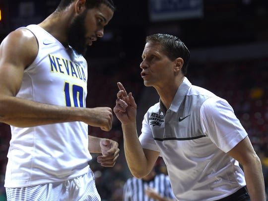 Nevada head coach Eric Musselman talks with Caleb Martin as they take on UNLV during the Mountain West Tournament.