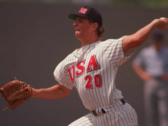 United States pitcher B.J. Wallace throws during the U.S. 10-0 shutout victory over Italy in Barcelona, Spain, July 28, 1992, at the Olympics. (AP Photo/Cliff Schiappa)
