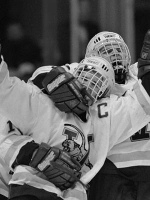 Vermont's Martin St. Louis, left, celebrates with teammates after scoring the winning goal against Lake Superior in their NCAA Division I East Regional game in Albany, N.Y. Saturday, March 23, 1996. Vermont won 2-1.