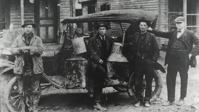 Knox County sheriff's deputies with a confiscated moonshine still circa 1922-23. Pictured are Ott Wagner, left, L.L. Robbins, Squire Tilman Greene Waggoner and John Wesley Bates.