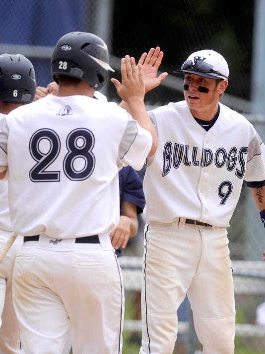West York's Brock Gladfelter (9) and Carson Fries slap hands during the PIAA Class AAA quarterfinals vs. Belle Vernon on Thursday in Altoona.