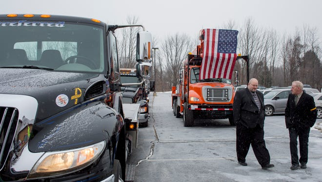 Drivers line up their trucks before the funeral service for Jason Schultz Wednesday, Jan. 20, 2016 at Ross Bible Church in Port Huron Township.