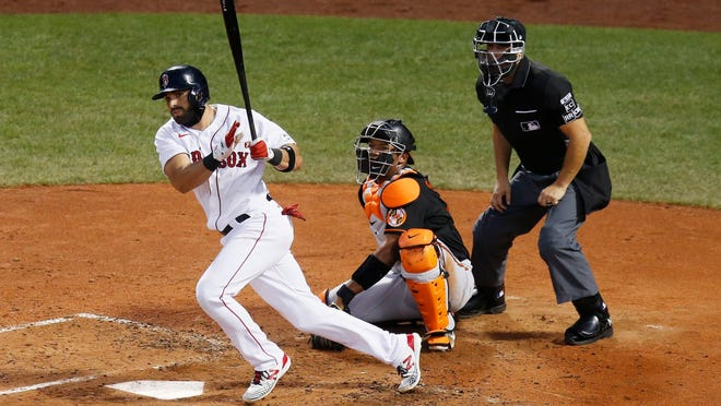 Red Sox second baseman Jose Peraza follows through on an RBI double in front of the Orioles' Pedro Severino during the third inning Friday night.