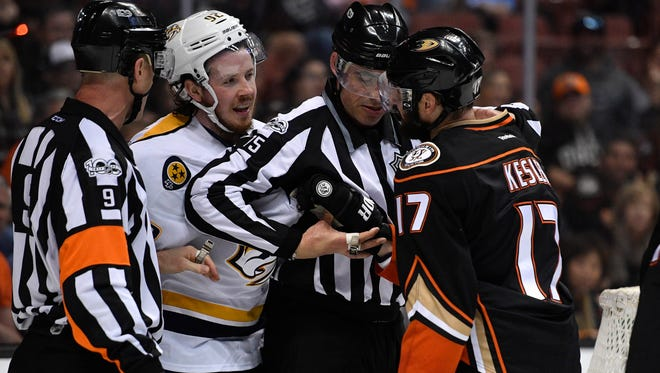 Nashville Predators center Ryan Johansen (92) and Anaheim Ducks center Ryan Kesler (17) are separated during the first period of game 1 of the Western Conference finals at the Honda Center in Anaheim, Calif., Friday, May 12, 2017.