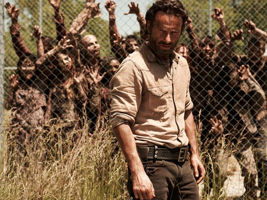 "Rick Grimes (Andrew Lincoln) and mega zombies in AMC's ""The Walking Dead."""