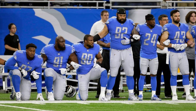 Sept. 24, 2017: Lions players link arms and kneel during the national anthem before the game against the Falcons at Ford Field. The Lions lost, 30-26.