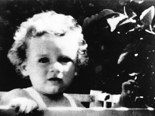 This is a 1932 photograph of Charles A. Lindbergh Jr., shortly before he was kidnapped on March 1st from his parents' new home at Hopewell, N.J. On May 12, the body of the 19-month-old baby was found in a shallow grave five miles away. Four years later on April 3, 1936, Bruno Hauptman was executed for the crime.