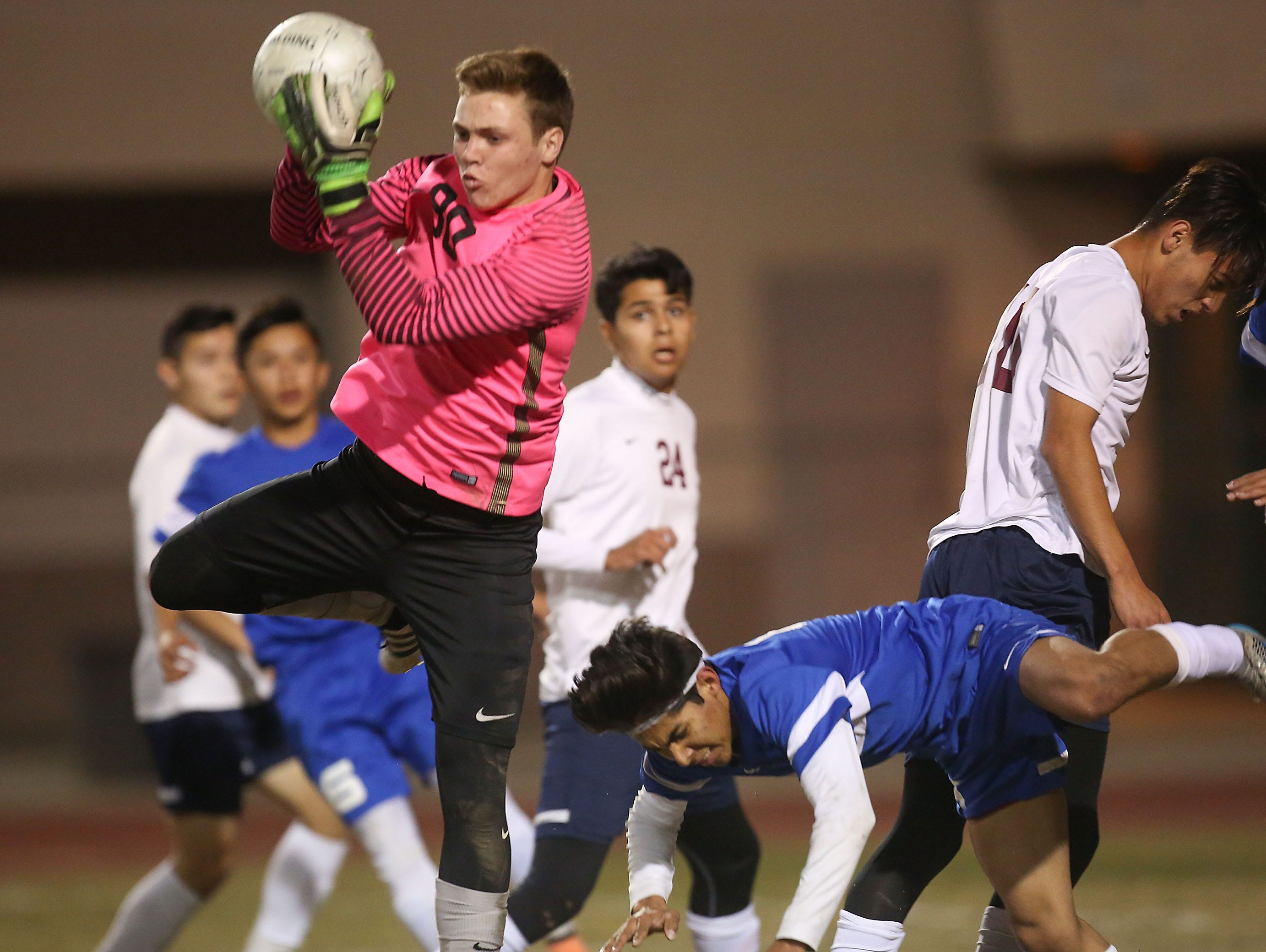 La Quinta goalkeeper Logan Prescott comes down with the ball during La Quinta's win, January 11, 2016.