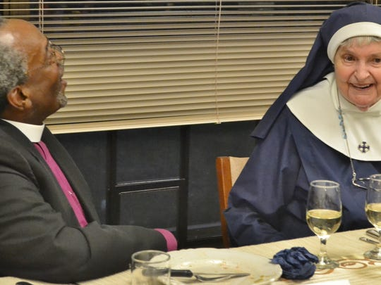 Sister Joan at dinner with the Most Rev. Michael Curry, the Bishop Visitor of the Community of the Transfiguration, in 2015.