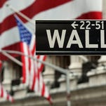 The Wall Street road sign is seen near the front of the New York Stock Exchange. / Stan Honda / AFP / Getty Images 2013 file photo