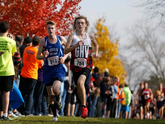 Ogden runner Andrew Stumbo (left) and Garner-Hayfield-Ventura