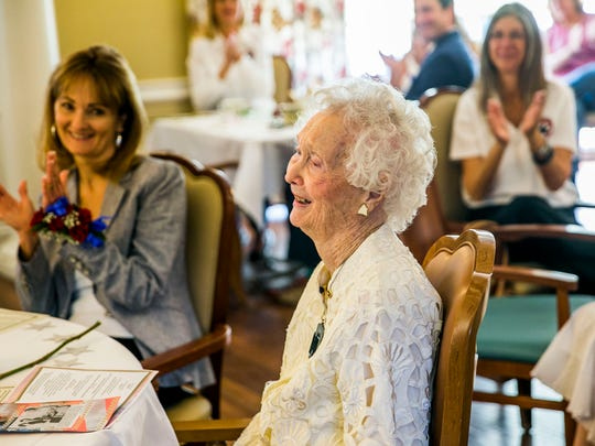 "Carlynn ""Polly"" Crews, the oldest Gold Star mother in Florida, is honored during a reception for the 90th anniversary of the founding of the American Gold Star Mothers at Villa Memory Care in East Naples on Saturday, March 24, 2018."