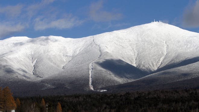 Mount Washington, right, and the presidential range is covered in snow in this 2013 file photo. The summit of Mount Washington was the second coldest spot on earth on Jan. 6, 2017,. according to the Mount Washington Observatory.