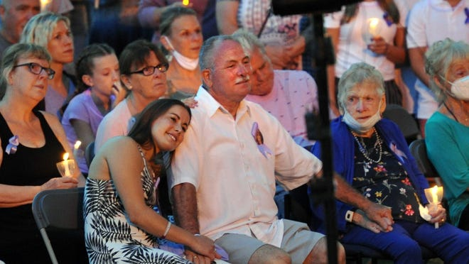 Julianna Melchionda rests her head on the shoulders of her dad, Bob, during a vigil for her late mother, Laurie Melchionda at Braintree Town Hall on Monday, June 22, 2020.