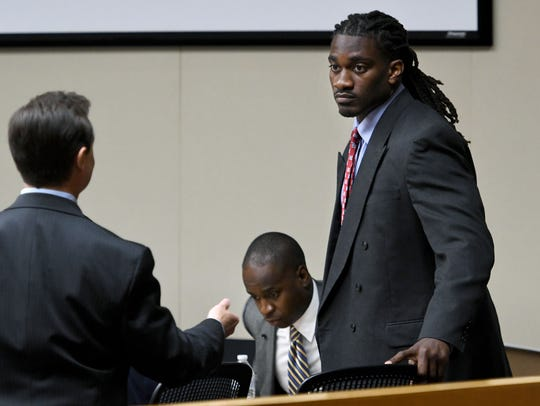 A.J. Johnson, standing, speaks to his attorney Stephen