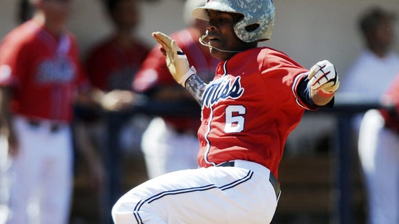 Mississippi's Errol Robinson (6) scores against Arkansas in an NCAA college baseball game at Oxford-University Stadium in Oxford, Miss., on Saturday, May 3, 2014. (AP Photo/Oxford Eagle, Bruce Newman) MAGS OUT, NO SALES, MANDATORY CREDIT
