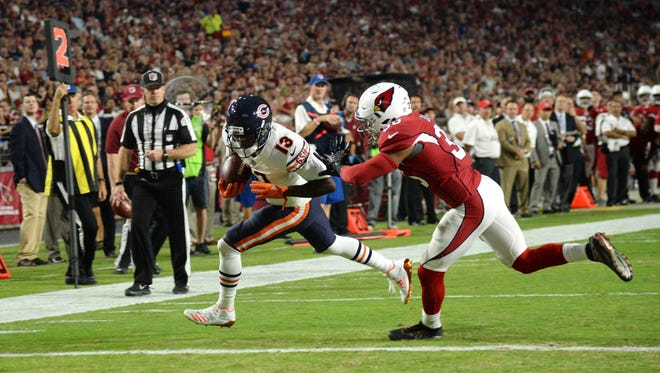 Aug 19, 2017: Chicago Bears wide receiver Kendall Wright (13) scores a touchdown after catching a pass against Arizona Cardinals safety Budda Baker (36) during the first half at University of Phoenix Stadium.