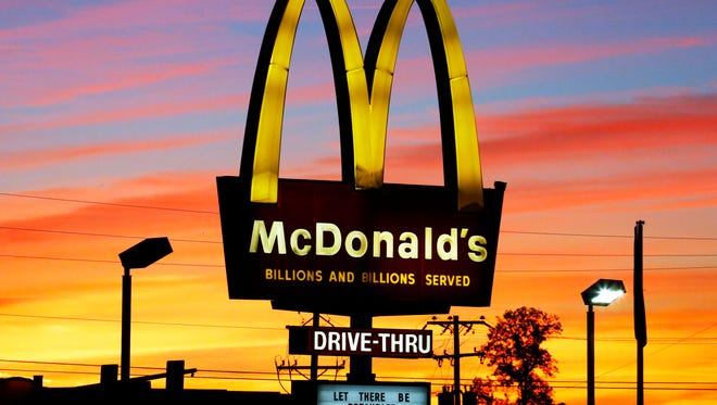 In this Oct. 10, 2015 photo, the sun sets behind a McDonald's restaurant in Ebensburg, Pa.