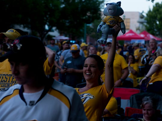 Predators fans gather in Strawberry Alley in downtown