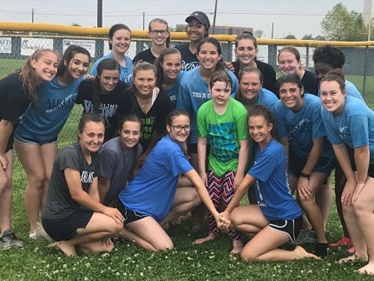 The Airline softball team poses with Emilie Gibson