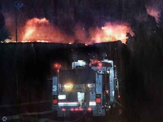 San Angelo firefighters battle a blaze May 18, 1998,