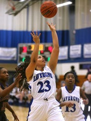 La Vergne's Chantel Maxwell (23) goes up for shot during