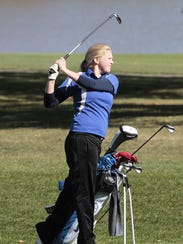 Rachel Hoferer of Mercy watches her ball fly toward