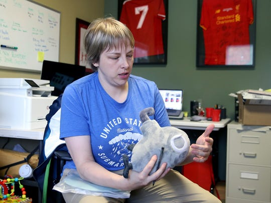 Alisha Weiss, the CEO at 16Submarines in Poulsbo, shows a plush submarine the company sells on its website.