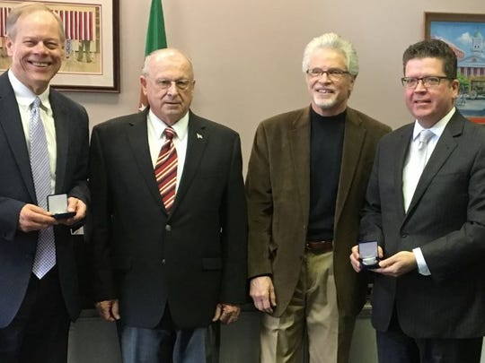 Paul Cullinane and Warren Elliott presented Letterkenny Chapel medallions to county commissioners Robert Ziobrowski, David Keller and Robert Thomas on Tuesday, Feb. 20, 2018.