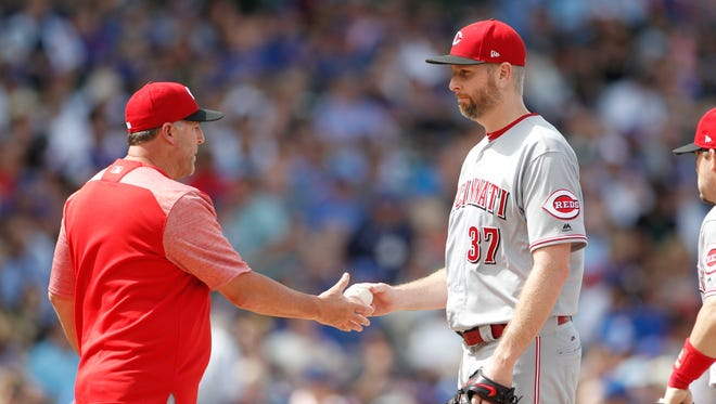 Aug 17, 2017; Chicago, IL, USA; Cincinnati Reds manager Bryan Price (38) is pulled from the game during the fourth inning against the Chicago Cubs at Wrigley Field. Mandatory Credit: Caylor Arnold-USA TODAY Sports