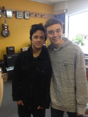 Fourteen-year-old Reed Reimer of Howard, right, was lucky enough to be taking a guitar lesson at Lloyd's Guitars in downtown Green Bay when Green Day singer Billie Joe Armstrong stopped in and posed for a photo with him. He went to the band's concert the next night at the Resch Center with his dad.