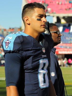 Titans quarterback Marcus Mariota (8) watches the end of the 38-20 loss from the sidelines .