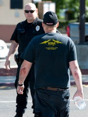 Visalia police investigate a shooting on Sunnyside Avenue just west of Mooney Boulevard on Monday, April 25, 2016. Police said a suspect stole display merchandise valued at more than $1,000 from Visalia Hobby and fled to a waiting vehicle just after 4 p.m. Two employees attempted to stop the suspect and then the truck he left in. One employee received minor injuries in that attempt as he fell away from the moving truck on Mooney. The other employee fired a single shot through the back window of the fleeing truck as it drove west on Sunnyside Avenue. The street was closed briefly because a bullet casing was found on Sunnyside. A truck matching that description was found abandoned in an alley a short while later. The investigation continues.