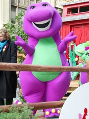 BARNEY NEW YORK - NOVEMBER 28: Barney the dinosaur rides on a float at the 76th Annual Macy's Thanksgiving Day Parade in Herald Square November 28, 2002 in New York City.   (Photo by Matthew Peyton/Getty Images)