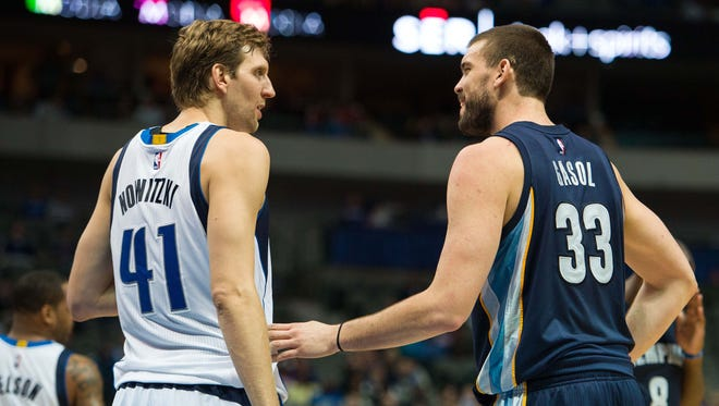Dallas Mavericks forward Dirk Nowitzki (41) talks with Memphis Grizzlies center Marc Gasol (33) during the first half at the American Airlines Center.