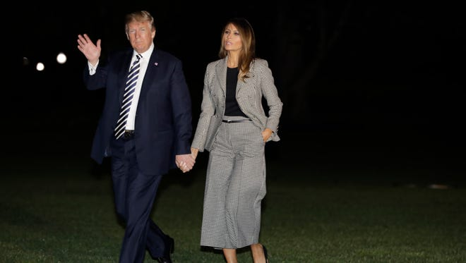 President Trump and first lady Melania Trump on the South Lawn of the White House upon their return from Joint Base Andrews in Maryland where they greeted three Americans just released by North Korea, May 10, 2018.